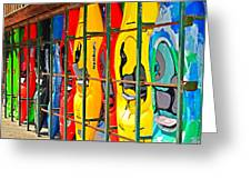 Kayaks In A Cage Greeting Card by Susan Leggett