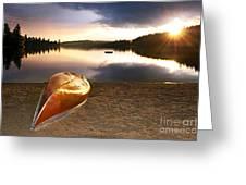 Lake sunset with canoe on beach Greeting Card by Elena Elisseeva