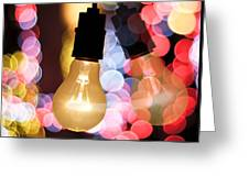 Light Bulb And Bokeh Greeting Card by Setsiri Silapasuwanchai