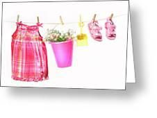 Little Girl Clothes And Toys On A Clothesline Greeting Card by Sandra Cunningham