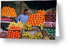 Market Vendor Selling Fruit In A Bazaar Greeting Card by Sami Sarkis