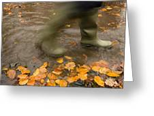 Person In Motion Walks Through Puddle Greeting Card by John Short