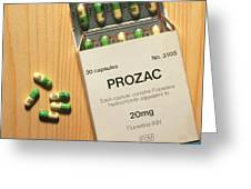 Prozac Pack With Pills On Wooden Surface Greeting Card by Damien Lovegrove