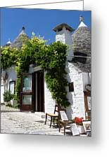 Street Scene In Alberobello Greeting Card by Carla Parris