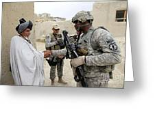 U.s. Army Soldier Shakes Hands With An Greeting Card by Stocktrek Images