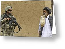 U.s. Army Specialist Talks To An Afghan Greeting Card by Stocktrek Images