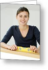 Woman Holding A Spirit Level Greeting Card by Carlos Dominguez