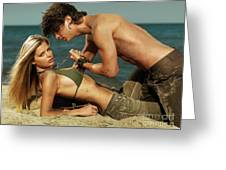 Young Couple on the Beach Greeting Card by Oleksiy Maksymenko