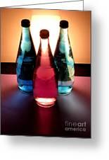 Electric Light Through Bottles Greeting Card by Caroline Peacock