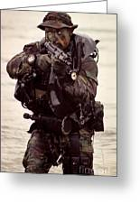 A Navy Seal Exits The Water Armed Greeting Card by Michael Wood