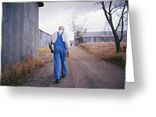 An Elderly Farmer In Overalls Walks Greeting Card by Joel Sartore