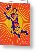 Aussie Rules Player Jumping Ball Greeting Card by Aloysius Patrimonio
