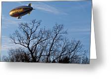 Blimp Over Wingfoot Greeting Card by Tim Fitzwater