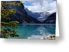 Canoe On Lake Louise Greeting Card by Larry Ricker