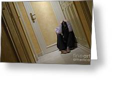 Depressed Woman Sitting In Corridor With Head In Hands Greeting Card by Sami Sarkis