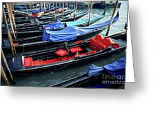 Empty gondolas floating on narrow canal Greeting Card by Sami Sarkis