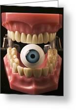 Eye Held By Teeth Greeting Card by Garry Gay