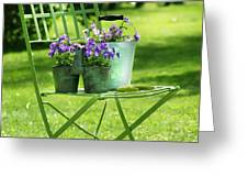 Green garden chair Greeting Card by Sandra Cunningham