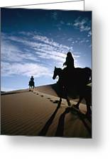 Horseback Riders In Silhouette On Sand Greeting Card by Axiom Photographic