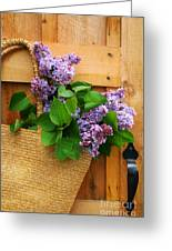 Lilacs In A Straw Purse Greeting Card by Sandra Cunningham