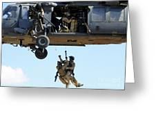 Pararescuemen Are Hoisted Into An Hh-60 Greeting Card by Stocktrek Images