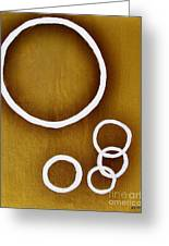 Rings On Gold Greeting Card by Marsha Heiken
