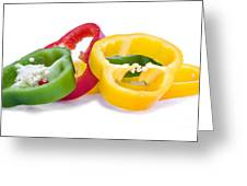 Sliced Colorful Peppers Greeting Card by Meirion Matthias