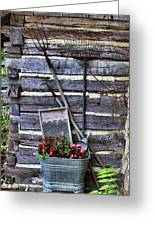Tall Log Cabin And Garden Tools Greeting Card by Linda Phelps