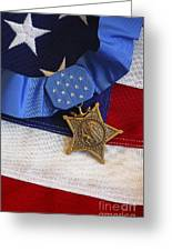 The Medal Of Honor Rests On A Flag Greeting Card by Stocktrek Images