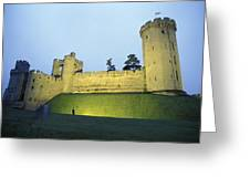 Warwick Castle At Dawn With A Man Greeting Card by Richard Nowitz
