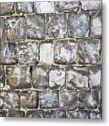 Flint Stone Wall Metal Print by Tom Gowanlock