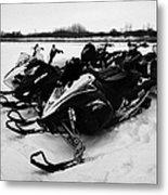 snowmobiles parked in Kamsack Saskatchewan Canada Metal Print by Joe Fox