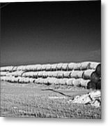 stack of frozen snow covered hay bales in a field Forget Saskatchewan Canada Metal Print by Joe Fox