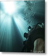 A Scuba Diver Surfacing And Looking Metal Print by Michael Wood