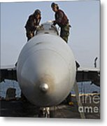 Airmen Clean The Canopy Of An Fa-18f Metal Print by Stocktrek Images