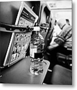 Bottle Of Water On Tray Table Interior Of Jet2 Aircraft Passenger Cabin In Flight Europe Metal Print by Joe Fox