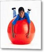 Boy Balancing On Exercise Ball Metal Print by Ron Nickel