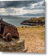Cannon At Llanddwyn  Metal Print by Adrian Evans
