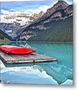 Canoes Of Lake Louise Alberta Canada Metal Print by George Oze