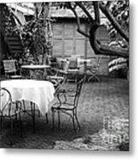 Courtyard Seating Metal Print by John Rizzuto