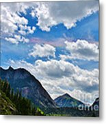 Iridescent Clouds Above Ouray Colorado Metal Print by Janice Rae Pariza
