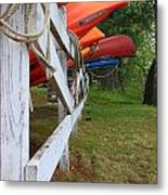 Kayaks On A Fence Metal Print by Michael Mooney