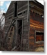 Ladder Against A Barn Wall Metal Print by Jeff Swan