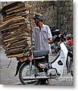 Man Carrying Cardboard On The Back Of His Scooter Metal Print by Sami Sarkis