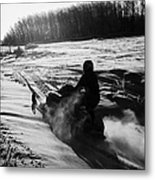 man on snowmobile crossing frozen fields in rural Forget canada Metal Print by Joe Fox