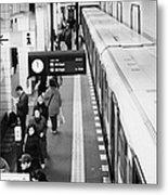 passengers along ubahn train platform Friedrichstrasse Friedrichstrasse u-bahn station Berlin Metal Print by Joe Fox