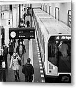 passengers on ubahn train platform as train leaves Friedrichstrasse u-bahn station Berlin Germany Metal Print by Joe Fox