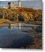 Reflecting On Nubble Lighthouse Metal Print by Susan Candelario