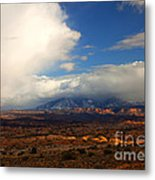 Storm Over The La Sals Metal Print by Mike  Dawson
