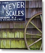 Weathered Wood Wagon Wheel Metal Print by David Letts